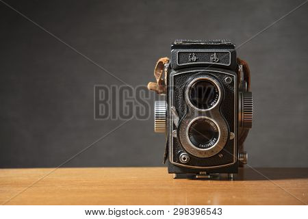 A Seagull 4 Tlr Twin Lens Reflex Camera With Brown Strap On A Table With A Grey Background, Nottingh