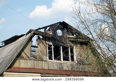 The Consequences Of The Fire Of A Country House. The Charred Window And The Destroyed Roof Of A Vill