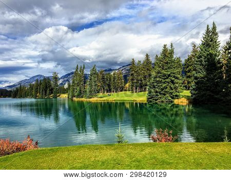 A Beautiful Golf Hole In The Jasper, Alberta, High In The Rockies Mountains.  The Tee Shot Is Over A