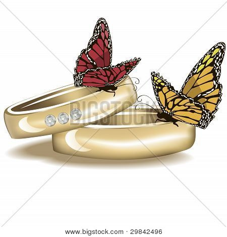 Wedding rings with  butterflies isolated on white