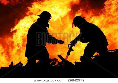 Two Fire Fighters And Huge Flames