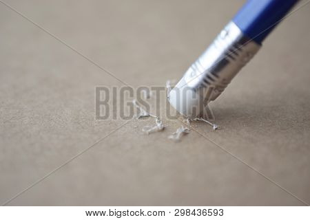 Pencil Eraser, Pencil Eraser Removing A Written Mistake On A Brown Paper, Delete, Correct, And Mista