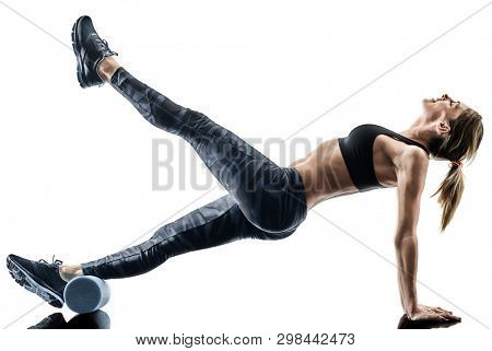 one caucasian woman exercising pilates fitness foam roller exercises isolated  silhouette on white background