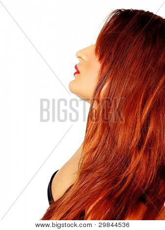beautiful young woman with long red hair wearing a black bra in profile with red lips on white background