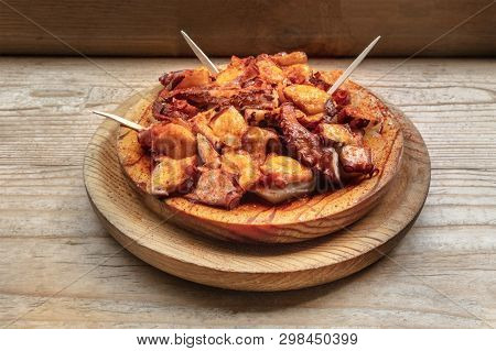 Pulpo A La Gallega, An Octopus With Boiled Potatoes And Paprika, A Typical Spanish Galician Dish, On