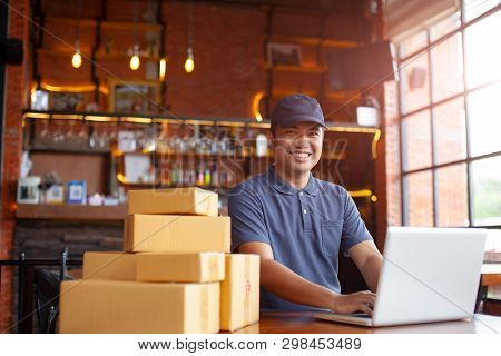 Online Shopping Young Start Small Business In A Cardboard Box At Work. The Seller Are Preparing Prod