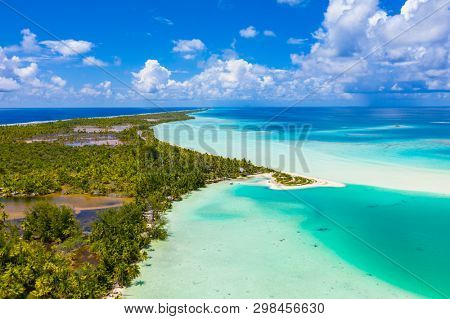 Drone aerial video of Fakarava atoll island motu Blue Lagoon, Teahatea and UNESCO Biosphere Reserve French Polynesia Tahiti, coral reef and Pacific Ocean. Tropical travel paradise in Tuamotus Islands.