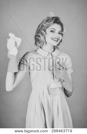 Retro woman cleaner on green background. Housekeeper in uniform with clean spray, duster. Cleanup, cleaning services, wife, gender. Cleaning, retro style, purity. Pinup woman hold soup bottle, duster. poster