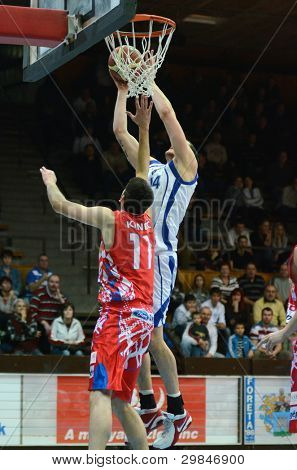 KAPOSVAR, HUNGARY - JANUARY 28: Jozsef Lekli (white) in action at a Hungarian Championship basketball game with Kaposvar (white) vs. Nyiregyhaza (red) on January 28, 2012 in Kaposvar, Hungary.