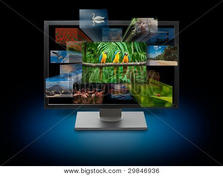 Monitor with images on multimedia background