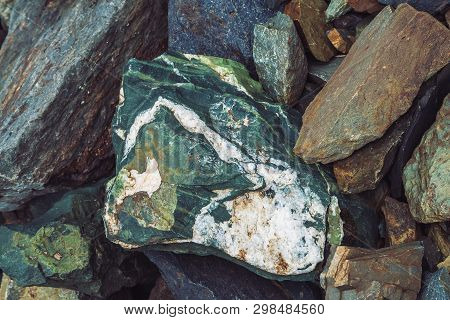 Multicolored Boulder Stream. Loose Rock Close Up. Randomly Scattered Stones In Nature. Amazing Detai