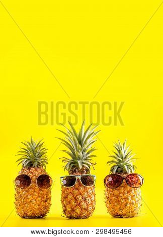 Creative Pineapple Looking Up With Sunglasses And Shell Isolated On Yellow Background, Summer Vacati