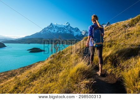 Woman hiker walks on the trail in the Torres del Paine National Park. Chile