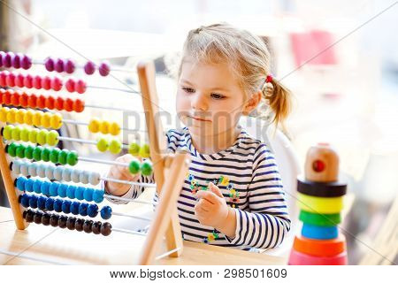 Adorable Cute Beautiful Little Toddler Girl Playing With Educational Wooden Rainbow Toy Pyramid And
