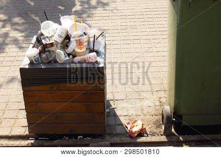 Vilnius Lithuania - 04 22 2019: Trash Bin Overfilled With Plastic And Paper Cups