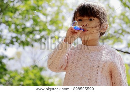 Japanese Girl Playing With Bubble Under The Blue Sky (4 Years Old)