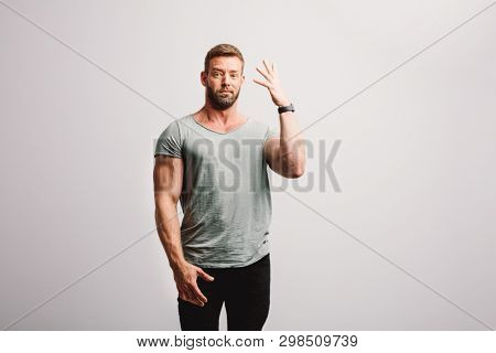 Man expressing his disgust with frown facial expression. Standing on white background