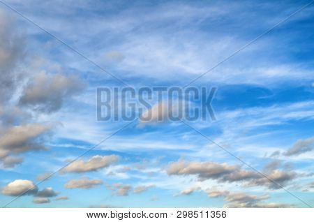 Blue cloudy sky background with blue dramatic colorful clouds, vast cloudy sky landscape, picturesque sky landscape scene, clouds in the vast sky