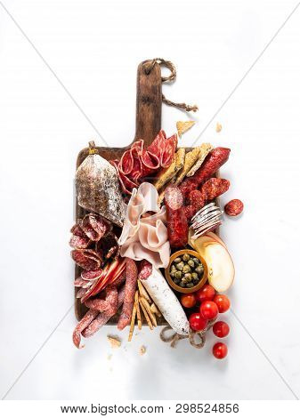 Cold Meat Plate, Charcuterie On White Background With Copy Space. Traditional Spanish Tapas Selectio
