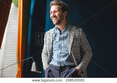 Happy fashion man looks outside poster