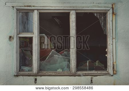 Window With Broken Glass In Old Building Wooden Window Frame With Partially Broken Glass In Old Aban