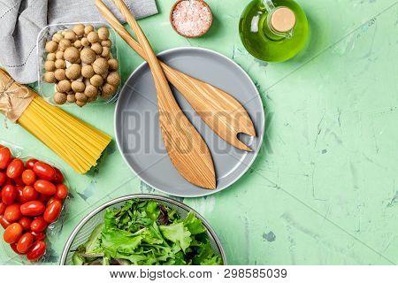Spaghetti, Shimeji Mushroom, Tomatoes, Olive Oil,  Pink Salt, Empty Ceramic Bowl, Wooden Spoons For