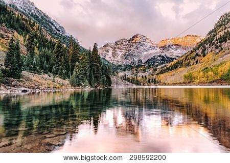 Maroon Bells And Maroon Lake With Reflection Of Rocks And Mountains In Autumn In The Rocky Mountains