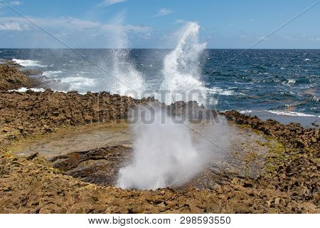 Water Is Spraying Up Both On The Coast And In The Blowhole