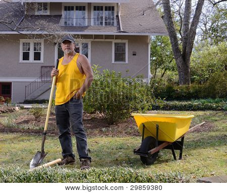 landscaper taking a break in a lawn.