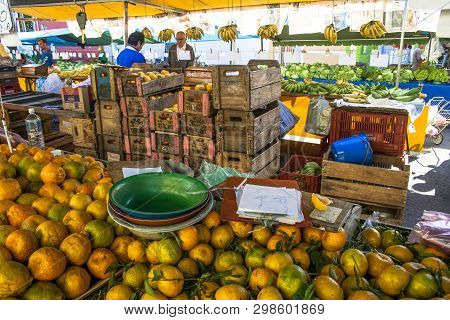 Sao Paulo, Brazil, July 05, 2008. Seller In A Stall Of Orange Fruits At Street Market In Sao Paulo,