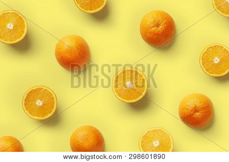 Fruit Pattern Of Fresh Orange Slices On Yellow Background. Top View. Copy Space. Pop Art Design, Cre