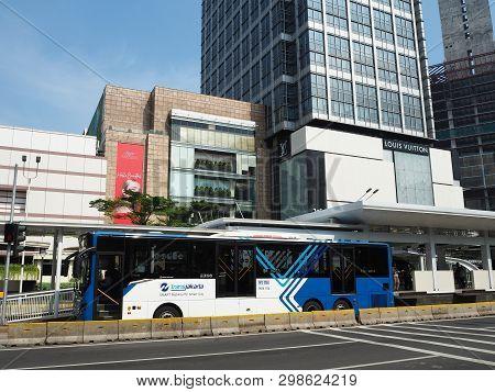 Jakarta, Indonesia - April 17, 2019: Transjakarta Bus Getting Some Passengers At Bundaran Hi Bus She