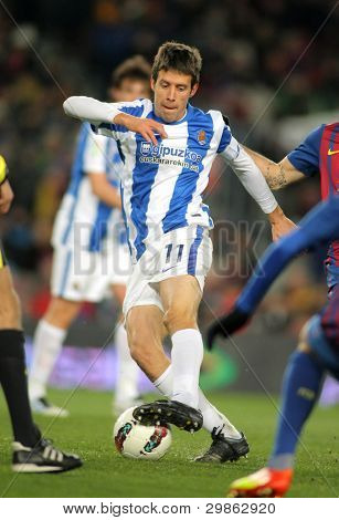 BARCELONA - FEB 4: Mikel Aramburu of Real Sociedad in action during Spanish league match against FC Barcelona at the Camp Nou stadium on February 4, 2012 in Barcelona, Spain