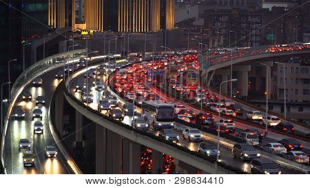 Traffic Jam In The Rush Hour On Highway. Cars On Bridges And Roads In Shanghai Downtown, China At Ni