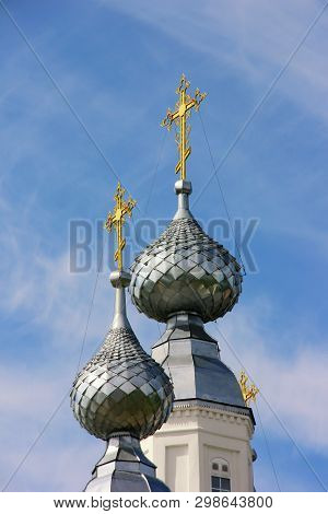 Gold Crosses On The Domes Of The Temple Against The Blue Sky. Christianity, Orthodoxy, Religion.