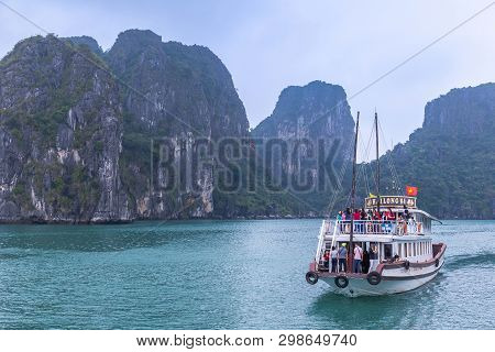 Halong Bay, Vietnam - March 6, 2019 : Tourist Ferry Boat In Halong Bay, The Unesco World Heritage Si