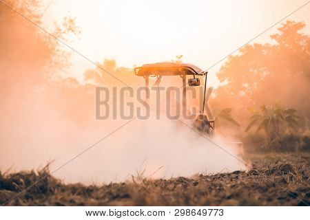 Farmer In Tractor With Sunset,tractor Plowing Fields To Prepare Land For Growing Crops,preparing Lan