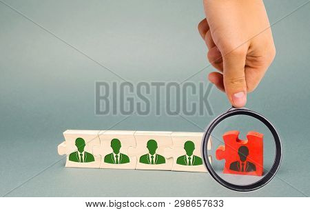 Wooden Puzzles With The Image Of Workers. The Concept Of Personnel Management In The Company. Dismis