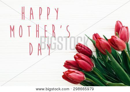Happy Mother's Day Text And Beautiful Red Tulips On White Wooden Background Flat Lay. Happy Mother D