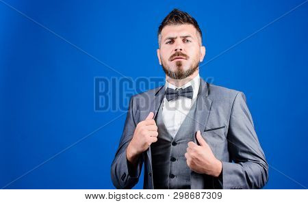 Man Adjust Suit With Bow Tie. Well Groomed Man With Beard In Formal Suit Jacket. Male Fashion And Ae