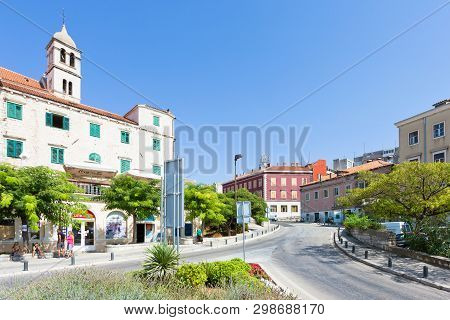 Sibenik, Croatia, Europe - August 31, 2017 - Tourists At A Street Fork In Sibenik