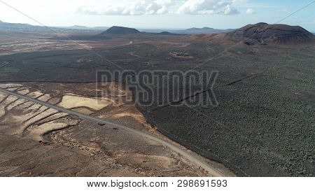 aerial photography of mountains and volcanic área fuerteventura