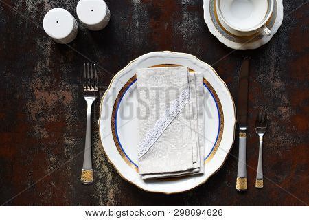 Empty Ceramic Plates And Cutlery. Tableware On Dark Background. Table Setting. Copy Space. Mock Up,