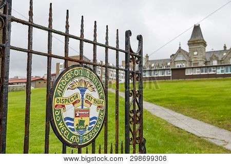 Painted Sign On Metal Doors As Entrance Into Anderson High School In Lerwick, Shetland Islands, Scot