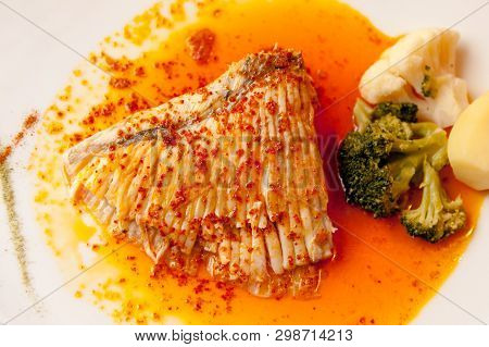 French Popular Aile De Raie (skate Wing) Fish Plate With Sause And Potato And Broccoli On A Side