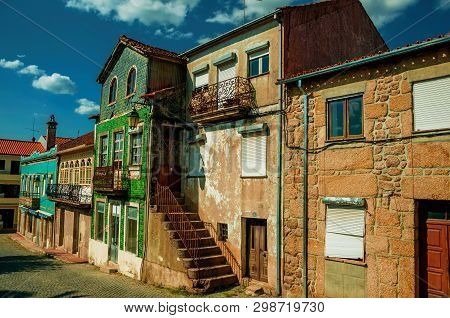 Old Houses With Worn Facade And Staircase On Deserted Alley, In A Sunny Day At Belmonte. A Cute Smal