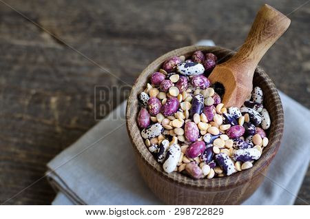 Assortment Of Dry Organic Beans And Lentils In Bowl On Rustic Wooden Table. Variety Of Raw Legumes.