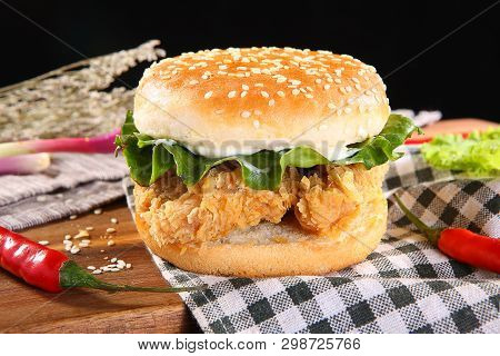 Spicy Double Chicken Burger On The Checkered Tablecloth