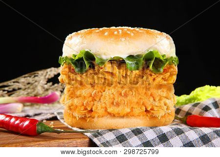 Supreme Double Spicy Chicken Burger On The Checkered Tablecloth