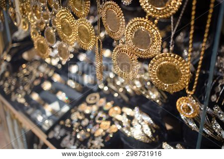 Golden Necklaces In Jewellery Shop Display With Ducats, Golden Coins. Skopje, North Macedonia